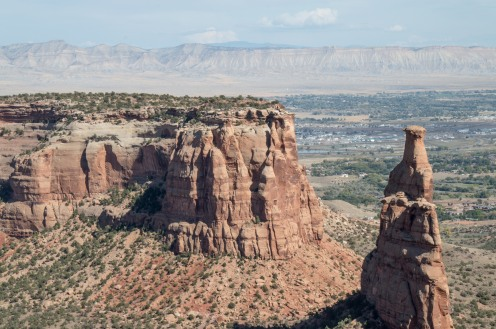 The stone formation to the right is the Colorado National Monument. They place a hug US Flag on top every July 4th.